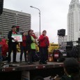 Carlos Montes and others on stage at May 1 protest for legalization.